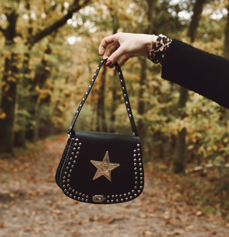 black leather bag with star + bagstrap short studs